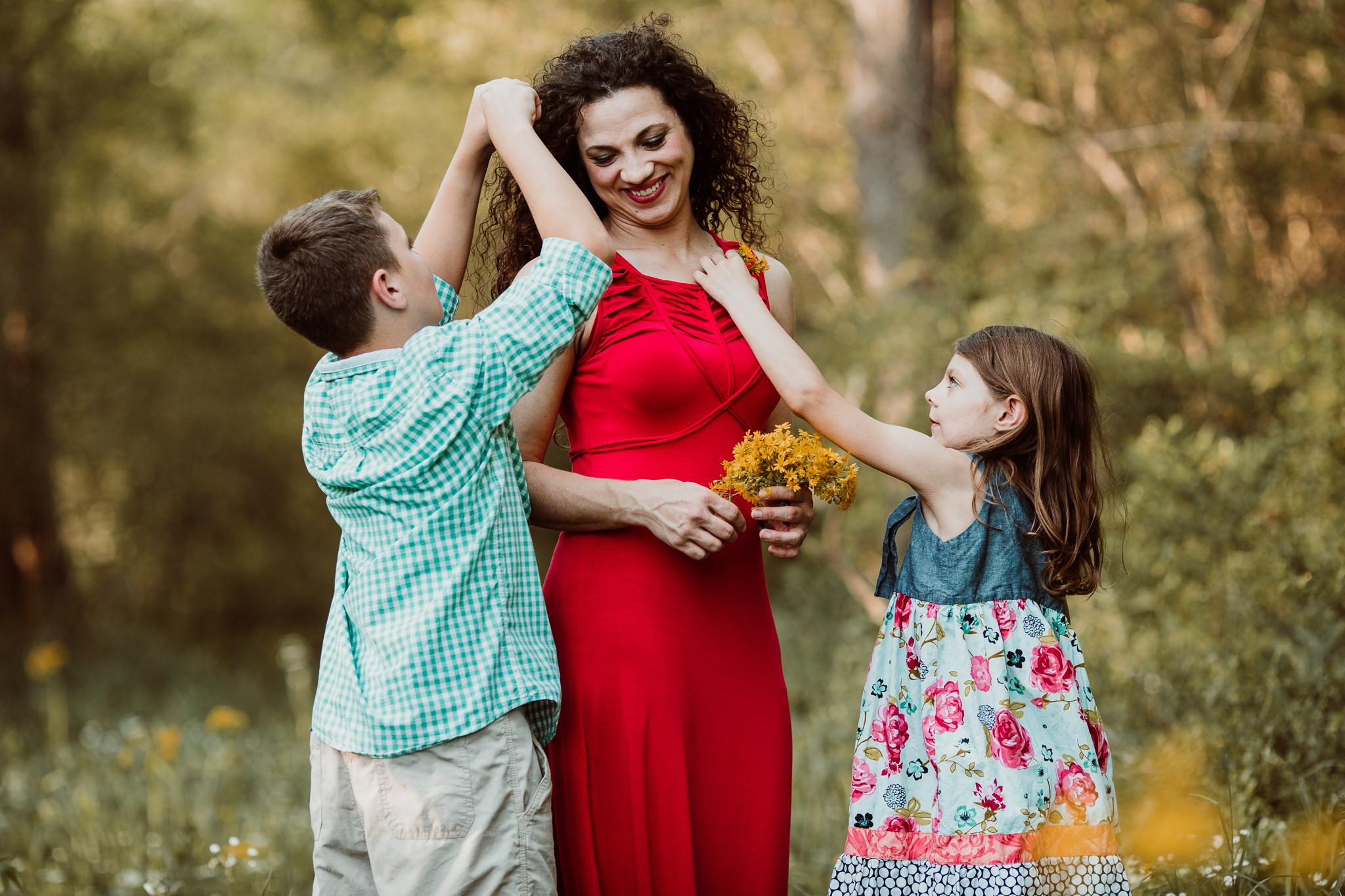 family plucking flowers
