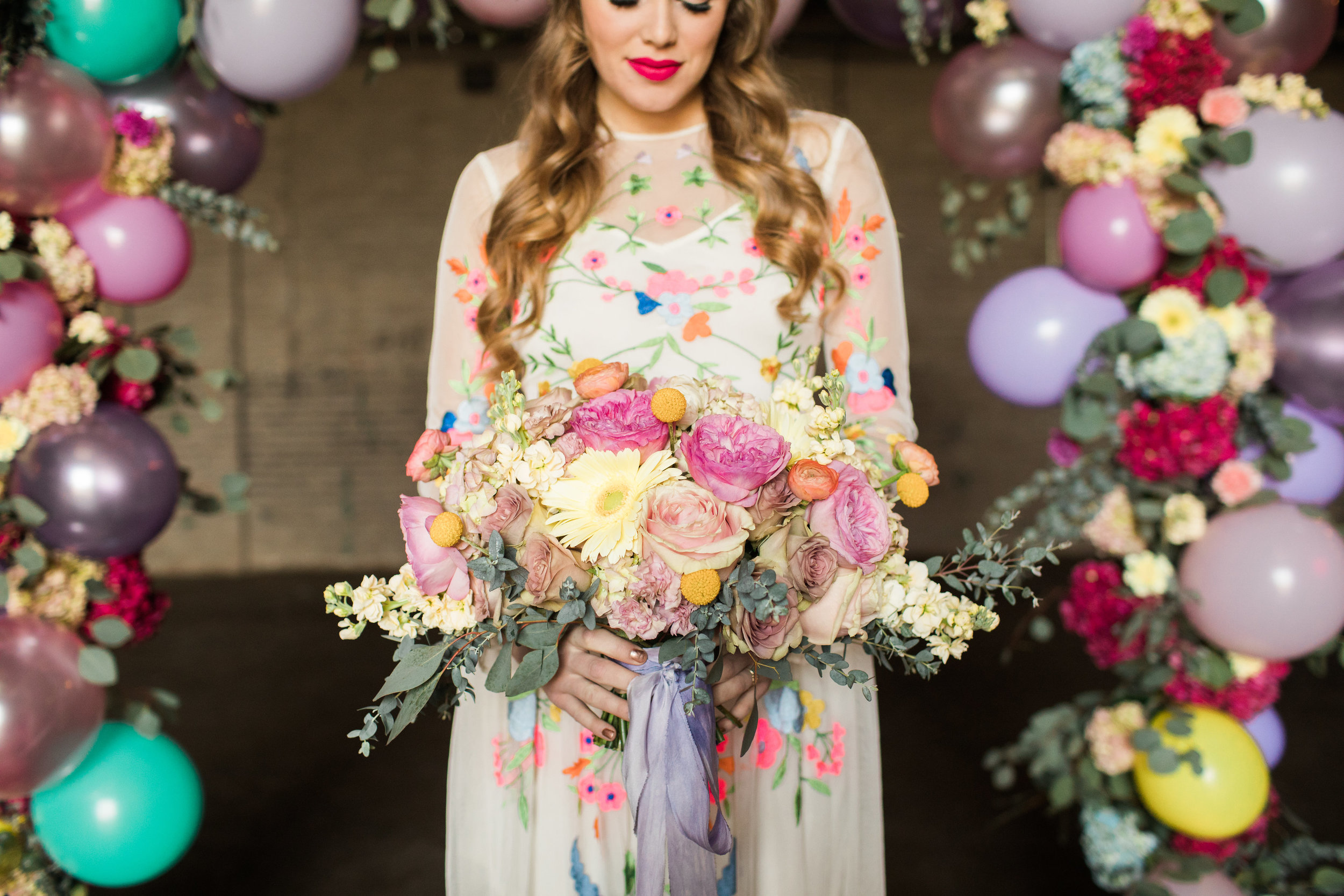 model Erin Marie, floral Design by  Floral Sense , ribbon by Rosemarine Textiles, photo by  Casey Brodley , hair and makeup by  Kyle Ann