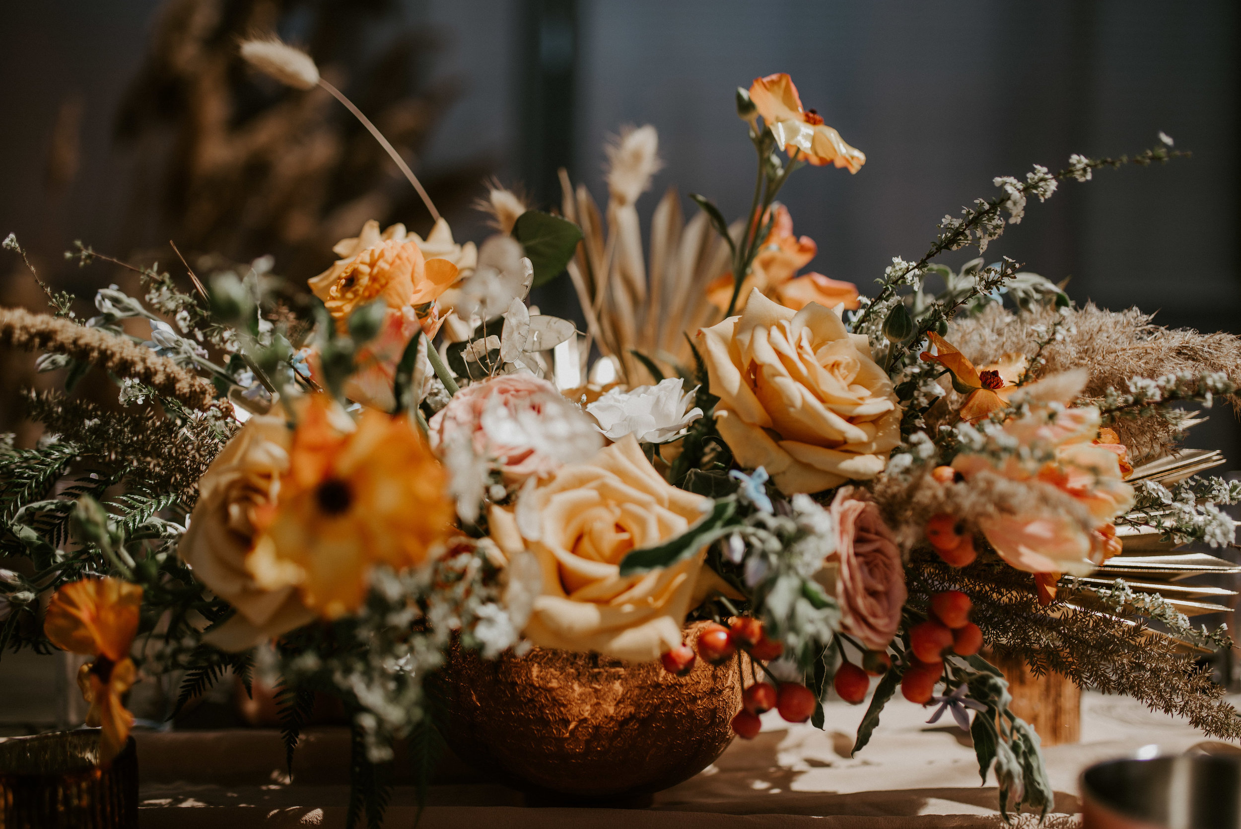 Beautiful and expansive peach toned floral centerpiece by    Studio Terrain.