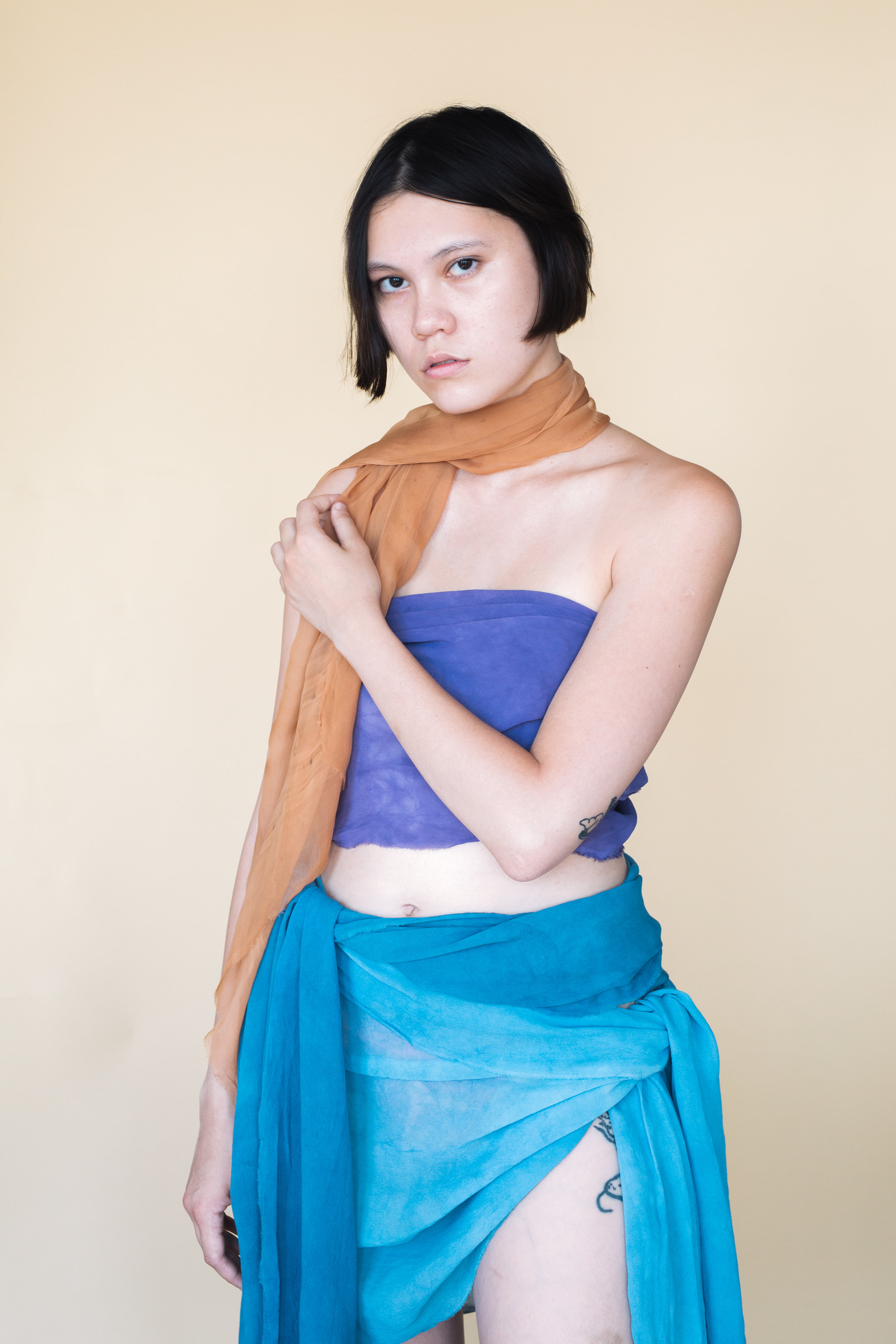 Table runners styled as a scarf, sarong and top.