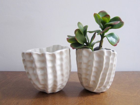 Sarah, from  Atelier Petit , is bringing one-off ceramic vases, mugs, platters and trinket trays, as well as cotton rope baskets in new sample styles. Plus, she'll have a bunch of her signature pinched pinch pots and some discounted seconds. Focusing on soft, organic shapes and a lot of blues and whites, Sarah makes everything by hand at home and at her studio co-op in Southwest Detroit.