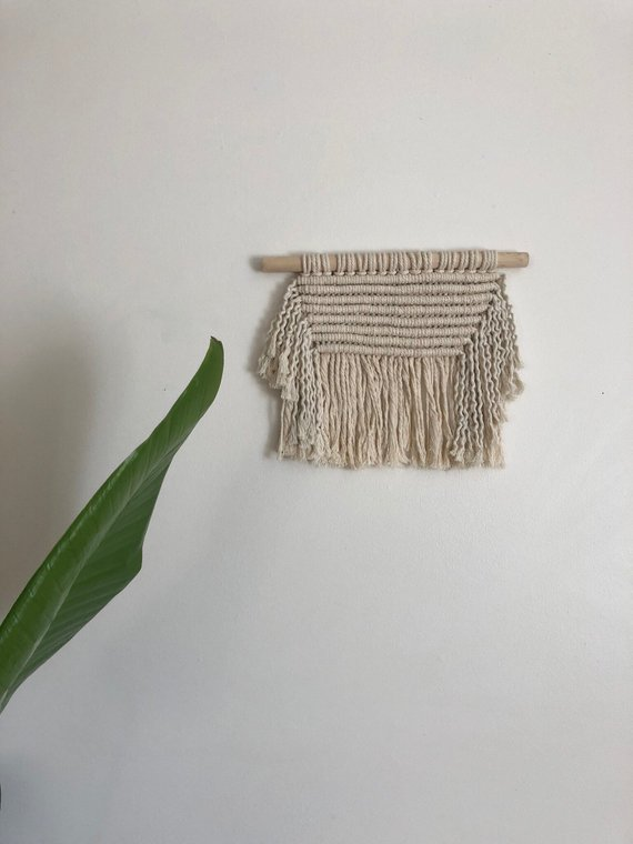 Magnolia Mercantile  creates fiber artwork including macrame, and weaving. Cait create wall hangings, and usable objects like keychains and plant hangers crafted with intention and purpose. She will be bringing plant hangers, wall hangings, and keychain styles that will be discontinued in 2018, along with discounted macrame ornaments from this holiday season. She will also be bringing samples of new work and staple styles for full price.
