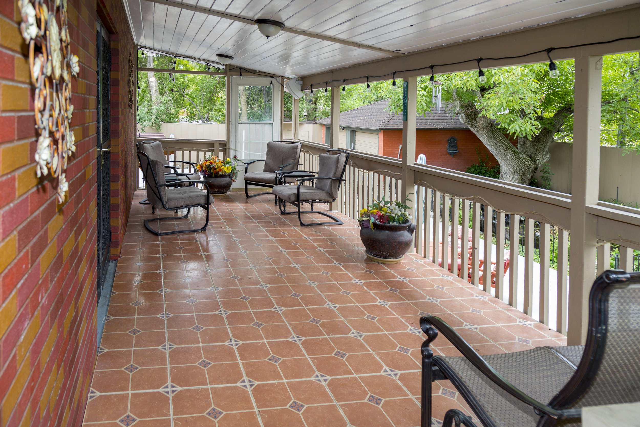 9. covered porch overlooking spa, koi pond _ BBQ.jpg