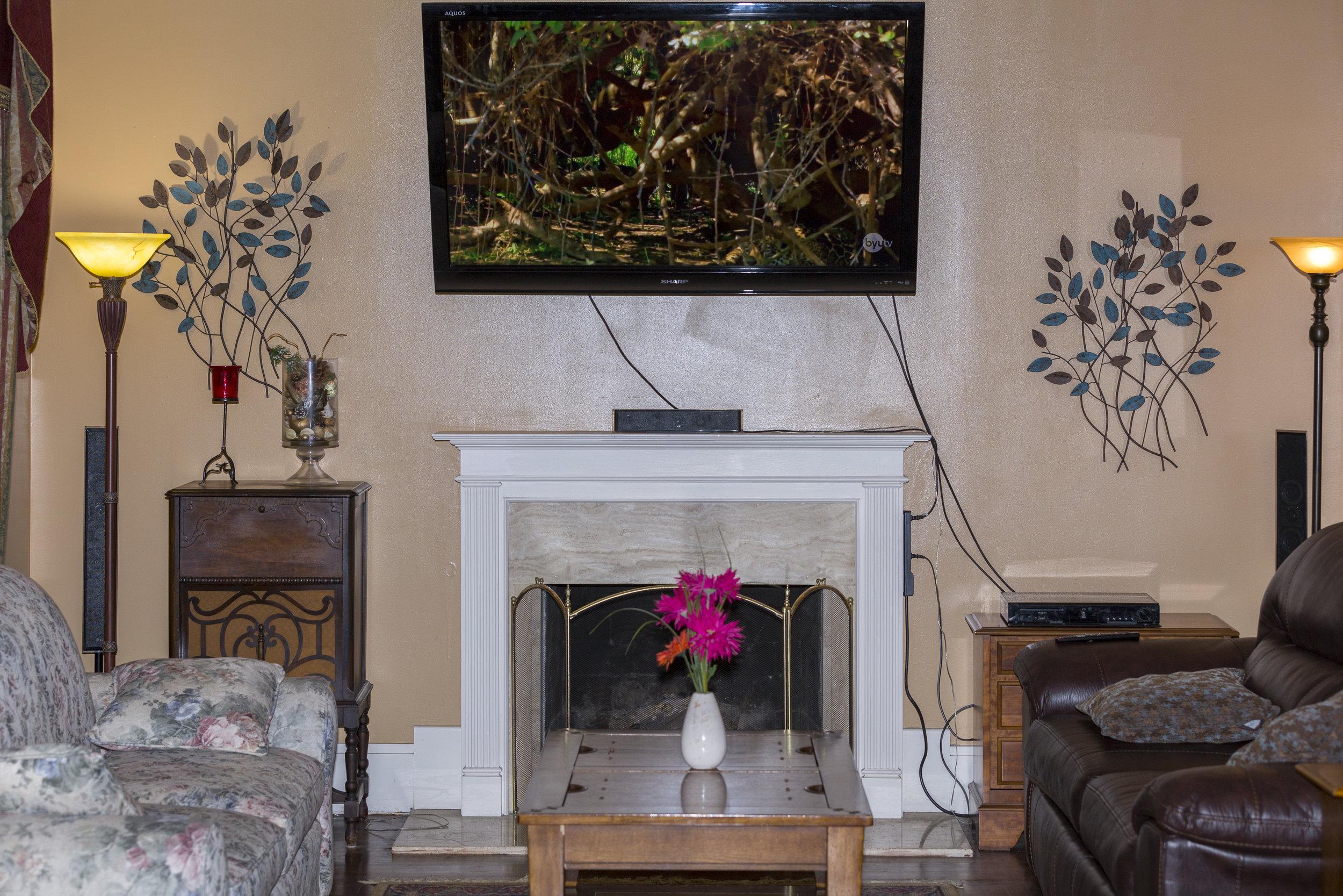 13. Parlor fireplace _ 60_ TV .jpg