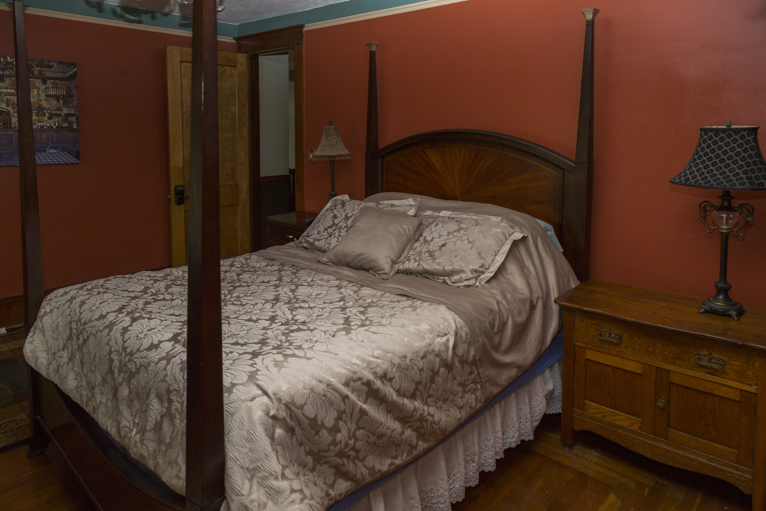 26. Southern Red Bedroom with Queen 4 post bed.jpg