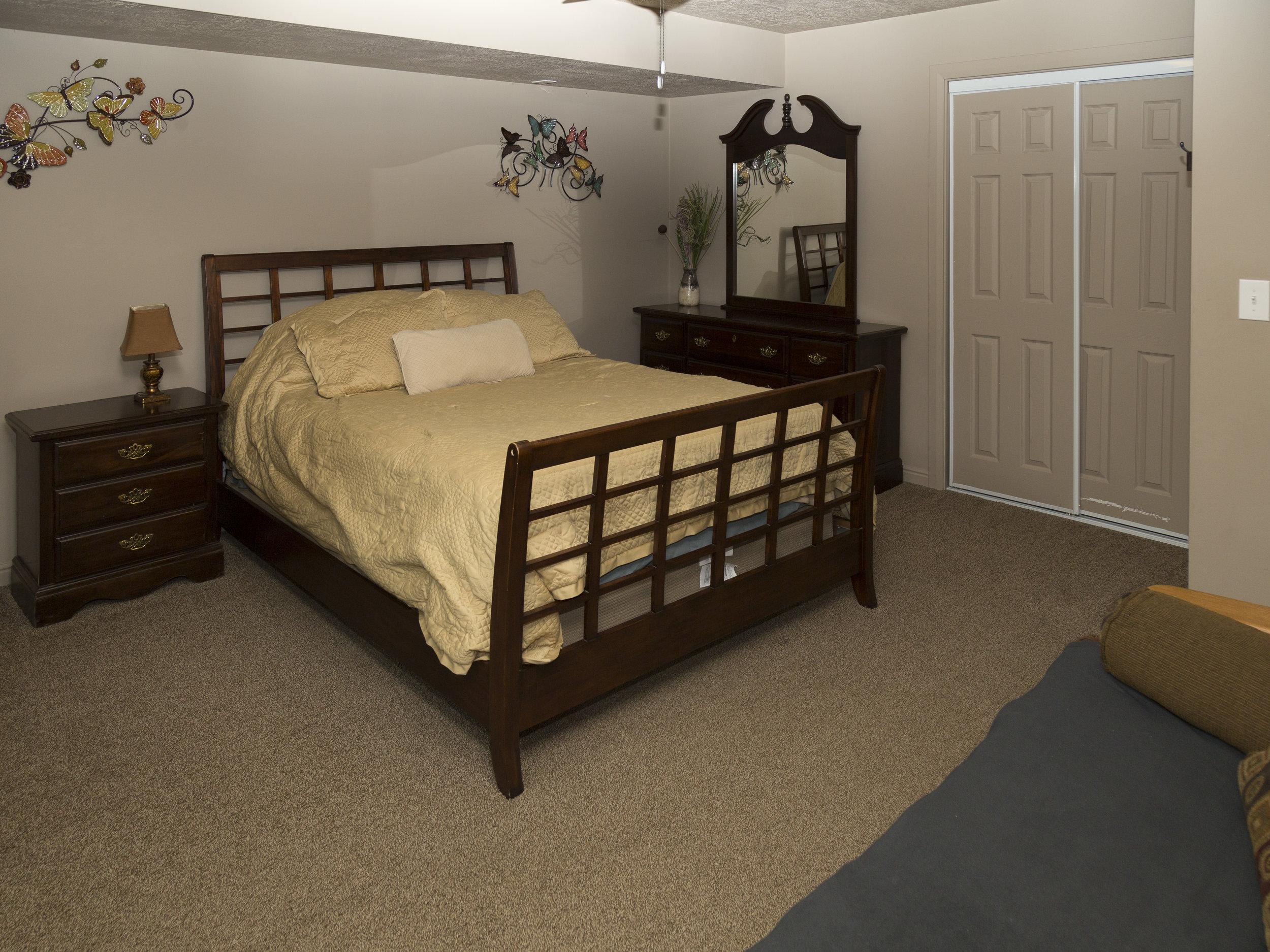 31. Basement north Bedroom with Queen Bed _ Futon.jpg
