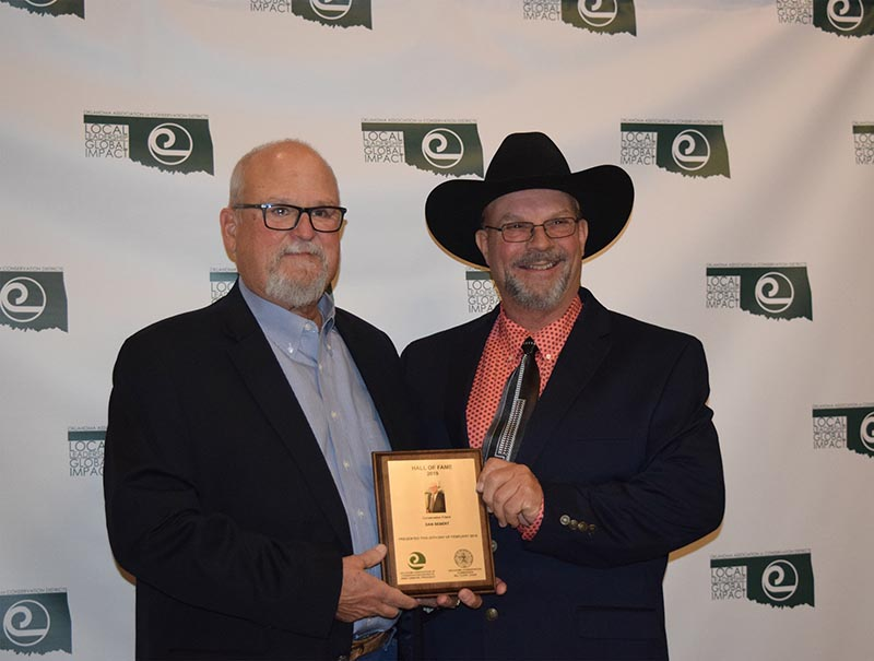 Dr. Dan Sebert (left), CEO-Executive Director of the National Watershed Coalition, was inducted into the Conservation Hall of Fame. (pictured with OACD president Jimmy Emmons)