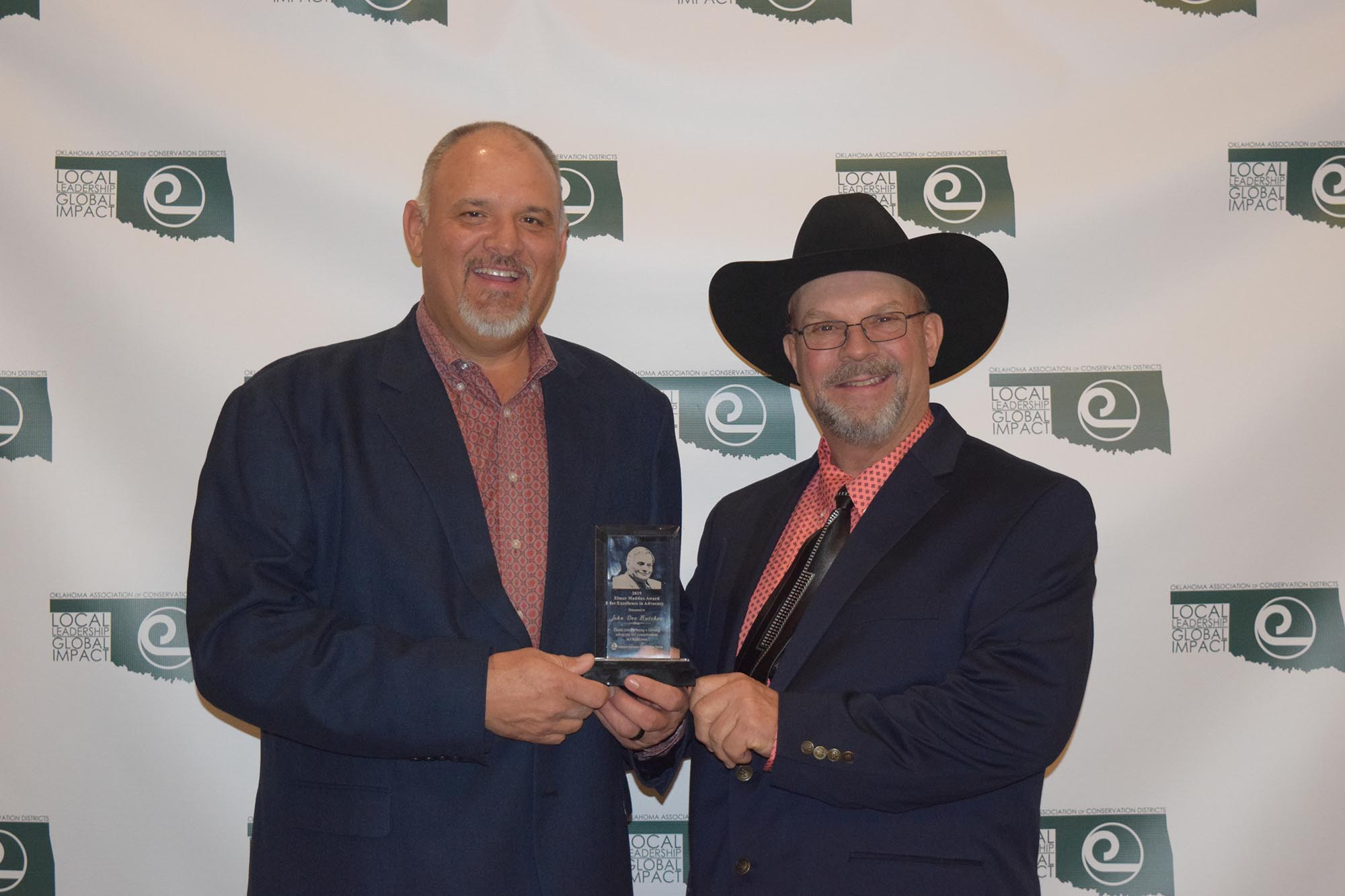John Dee Butchee (left), Jackson County Conservation District Manager, received the second annual Elmer Maddux Award for Conservation Advocacy and Stewardship (pictured with OACD president Jimmy Emmons)