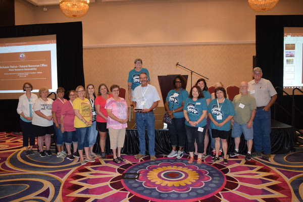 The South Central Region Conservation District Employees Association on July 22 presented their 2019 Distinguished Service Award to Trey Lam, Executive Director of the Oklahoma Conservation Commission. The award was presented during the 2019 South Central Region of the National Association of Conservation Districts (NACD) Meeting in Thackerville.