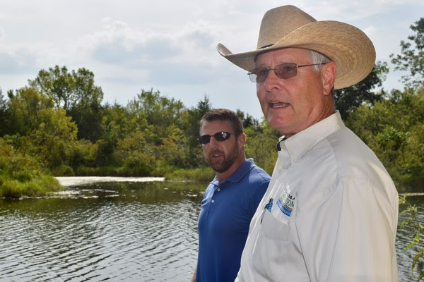 U.S Congressman Markwayne Mullin is shown with Robert Toole, Director of Abandoned Mine Land (AML) Reclamation Program for the Oklahoma Conservation Commission (OCC), recently near Porum at an abandoned coal mine strip pit to discuss the successes and the continued significant importance of the Abandoned Mine Land (AML) Reclamation Program.