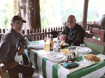 Pauline's husband, Richard, enjoying a meal with our new friend and local guide, Fidel