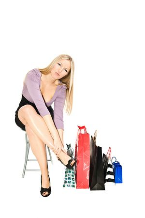 6719754_S_shopping_feet_hurt_tired_woman_heels_packages_sitting.jpg