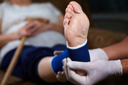34472527_S_laser_surgery_heel_pain_doctor_woman_patient_bandage_post_op.jpg