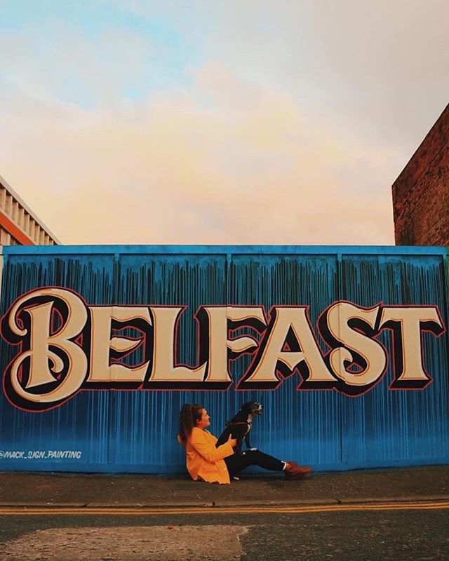 "😍Another favourite from earlier this year🐶 There are a lot of great pieces of street art popping up across Belfast. Here's another great addition. Happy Wednesday. ⚡️🙌🏻 🎨 by @mack_sign_painting 📍Sunflower Bar, Belfast - N.Ireland 📷: @sashaferg ・・・ ""People always ask, why stay here? Why not move to Berlin, London or America to do something arty? Well I have to say from the 26 countries the lil place I was born has to be one of the best, for crazy amazing people, the building art scene. I'm determined to stay here & get into illustration, work my ass off. Someday hopfully someone will give me a chance 🍄 For now it's me and Mollie moo against the world 🌍"" - @sashaferg . . . . . . . #Belfast #VisitBelfast #ExploreBelfast #streetart #discoverni #NorthernIreland  #thediscoverer #fubiz #myfeatureshot #iamtb #worldpackers #wonderful_places  #trip #travel #instatravel #wanderlust #travelphotography #travelgram #explore  #photooftheday #picoftheday #photography #urban #citylife #city #architecture #architecturelovers #urbanphotography #archidaily"