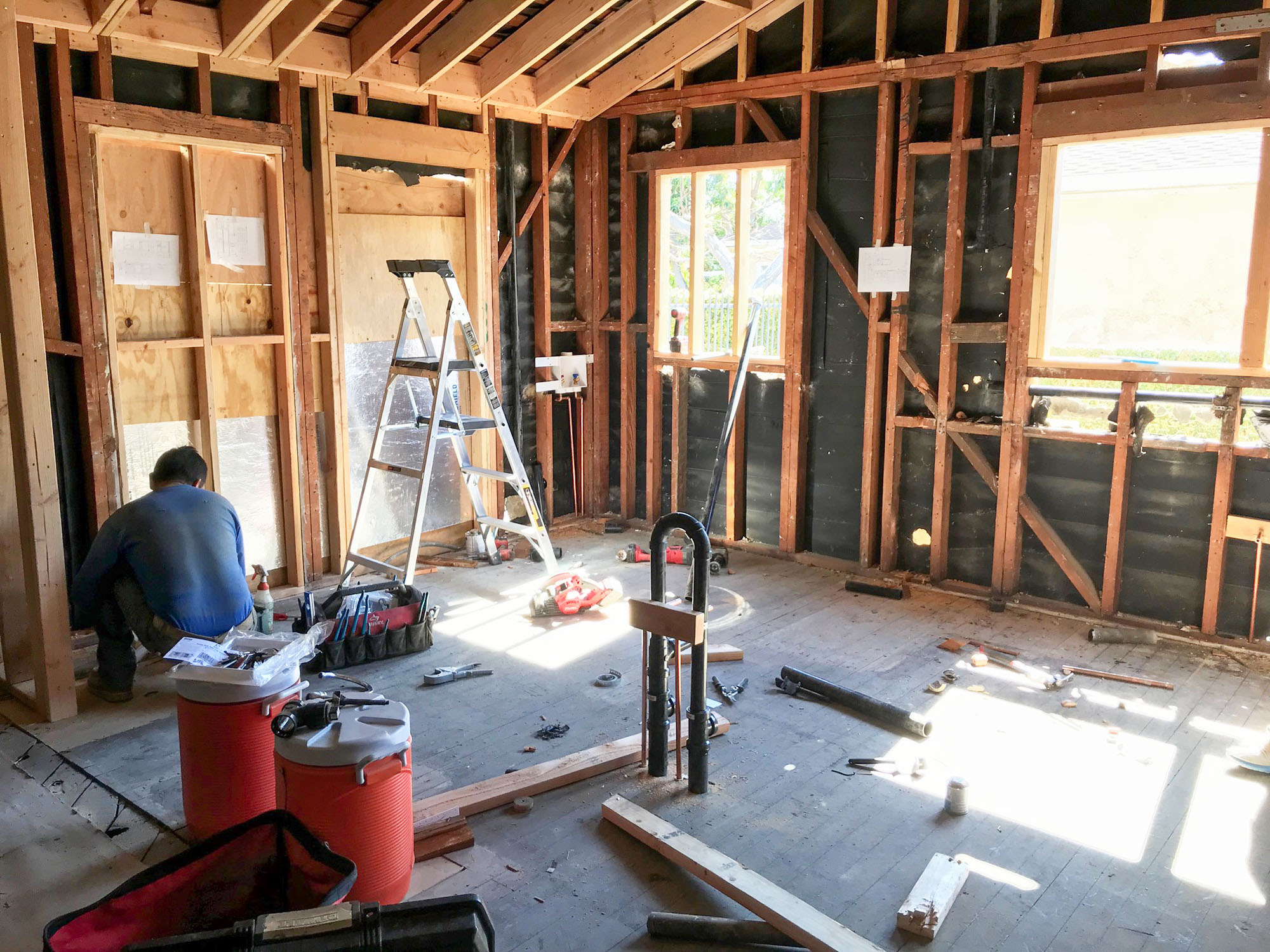 Demolition, framing and rough plumbing and wiring of the house.