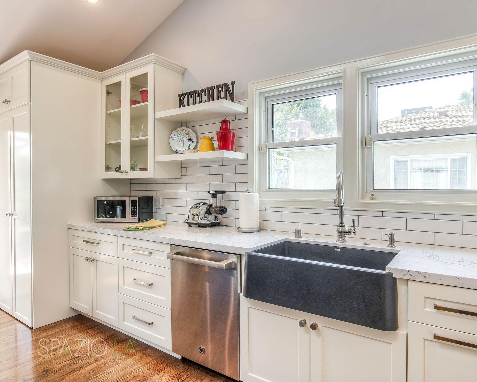 Custom shaker cabinets, white Caesarstone quartz countertops, Bosch appliances and farmhouse style Blanco sink.