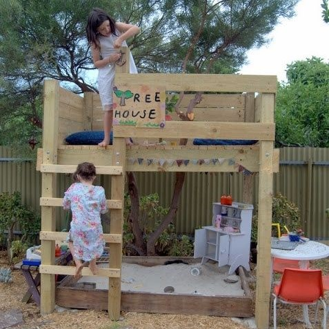 Pallet tree house with sand pit