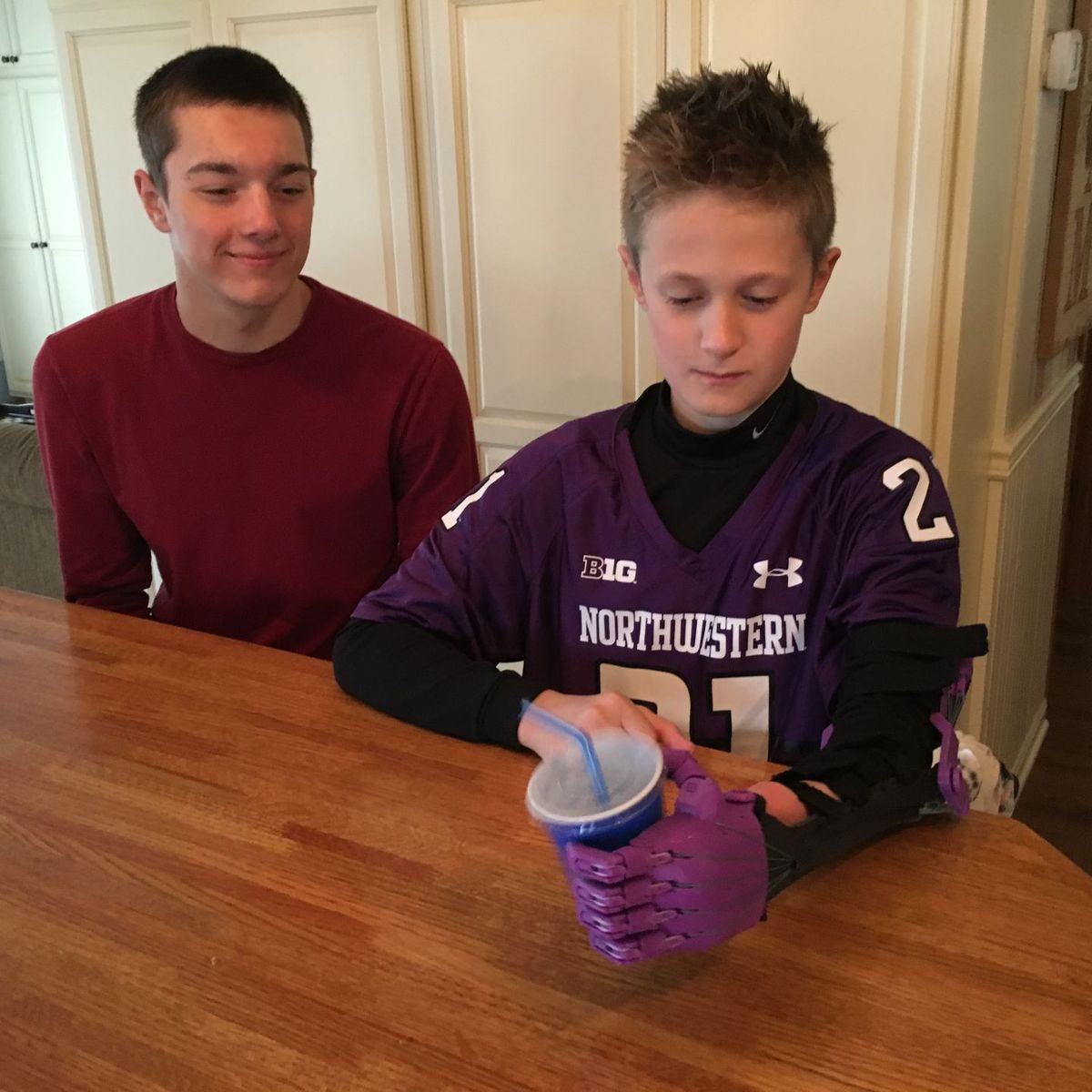 - Jonah Friedrich, 11, born without a left hand, demonstrates the new hand and arm Ian Bormett, left, made for him using his high school's 3D printer.