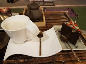 Delicious vegan chocolate cake and steamed caramel soya milk