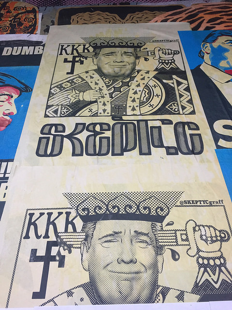 """Copy of Picture of Trump as a playing card King that says """"Skeptic"""" and with the KKK in the background"""