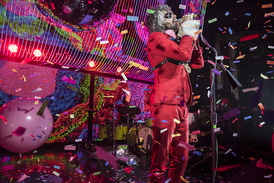 The Flaming Lips' Wayne Coyne performing under a downpour of confetti.  PHOTO BY ALEX LUPUL