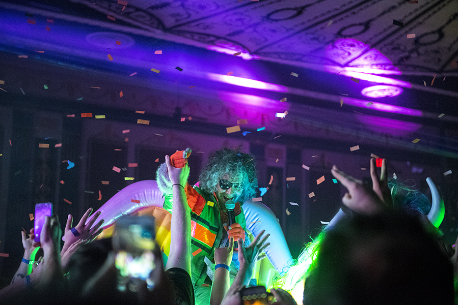 Wayne Coyne riding a neon unicorn through the crowd.  PHOTO BY ALEX LUPUL