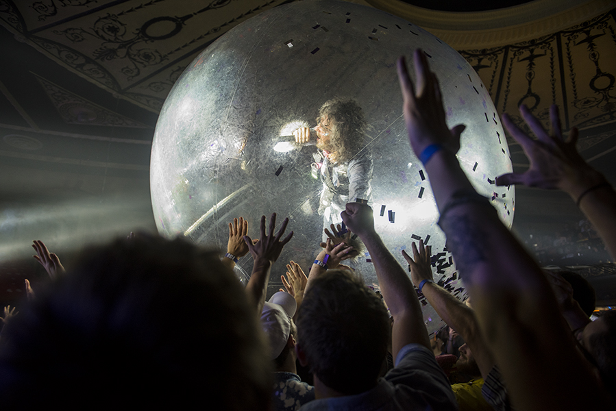 """Wayne Coyne interacting with the crowd during their cover of David Bowie's """"Space Oddity.""""  PHOTO BY ALEX LUPUL"""