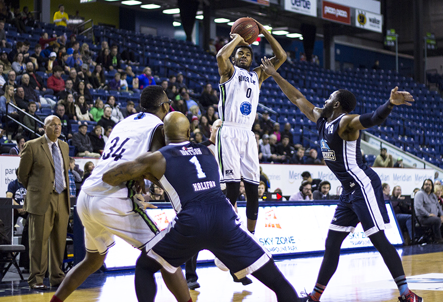 The Niagara River Lions' Jaylon Tate releases a three-point shot against the Halifax Hurricanes.  PHOTO BY ALEX LUPUL