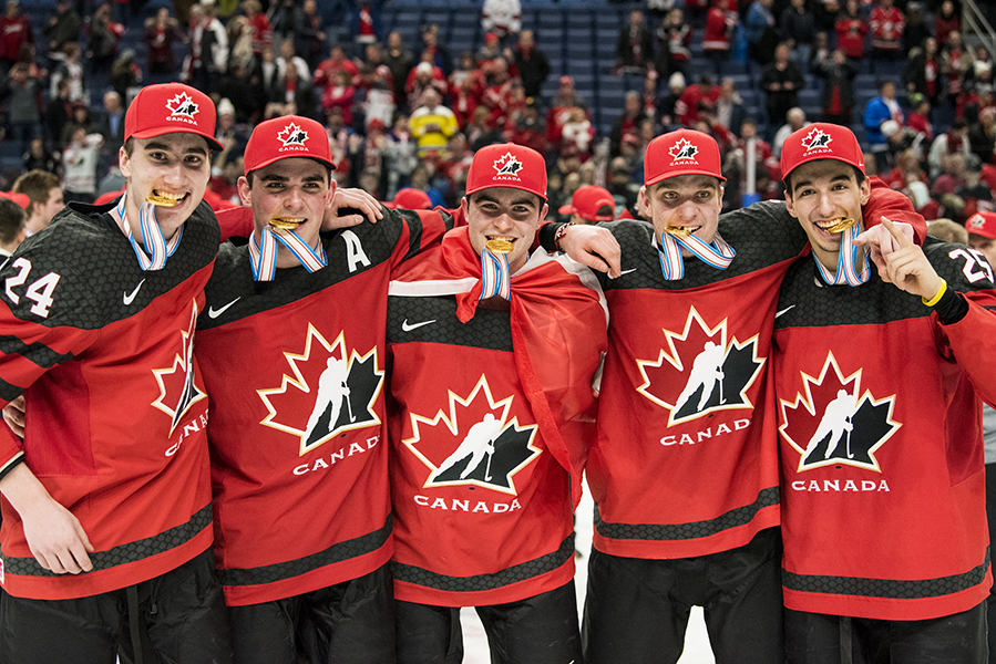 Team Canada players (L-R) Alex Formenton, Kale Clague, Dillon Dubé, Robert Thomas and Jordan Kyrou pose with their gold medals following their win at the 2018 IIHF World Junior Championship.