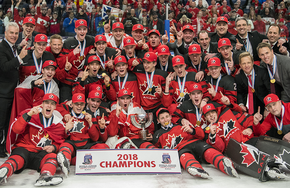 Team Canada poses for a photo following their victory at the 2018 IIHF World Junior Championship.