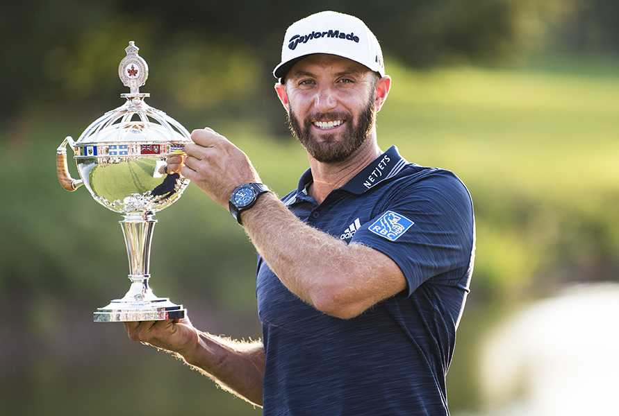 Dustin Johnson poses on the eighteenth green of Glen Abbey Golf Club after winning the RBC Canadian Open on July 29, 2018.