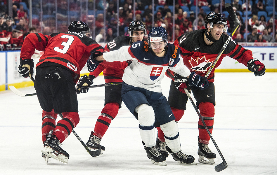 Martin Bodak of Slovakia slips by Team Canada's Conor Timmins (#3), Michael McLeod (#20) and Jonah Gadjovich (#11) during the World Junior Hockey Championship in Buffalo, NY.