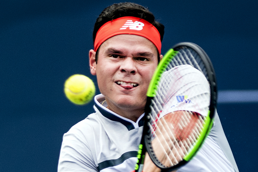 Canadian tennis player Milos Raonic keeps his eye on the ball at the 2018 Rogers Cup in Toronto, ON.