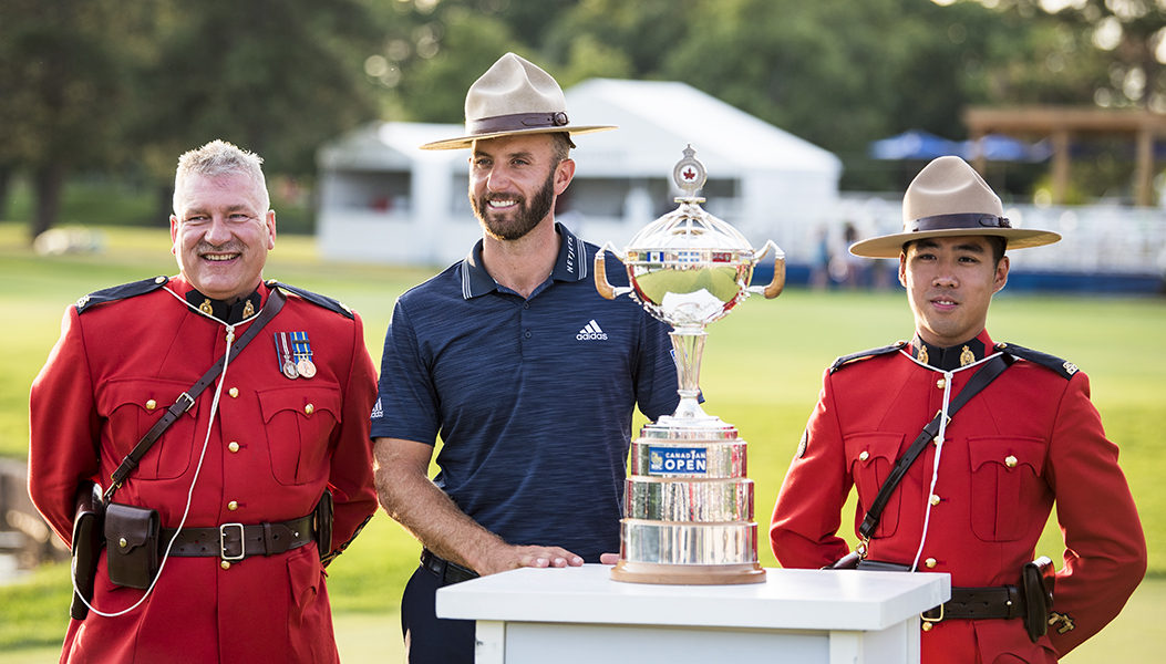 Dustin Johnson poses with RCMP officers following his victory at the RBC Canadian Open.