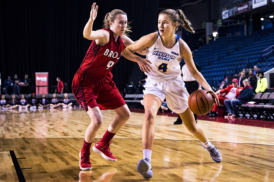 Miranda Smith (#9) of the Brock Badgers guards Marin Scotten (#4) of the Ryerson Rams during regular season play on November 17, 2018 at the Meridian Centre in St. Catharines, Ontario, Canada.