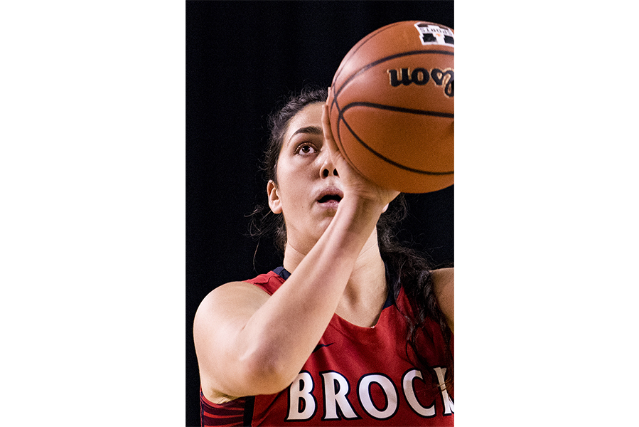 Sofia Croce of the Brock Badgers focuses on a free throw during OUA basketball action on November 17, 2018 at the Meridian Centre in St. Catharines, Ontario, Canada.