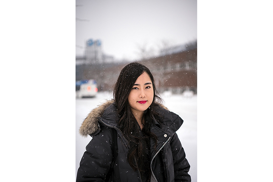 Hailey Song, a Niagara College Student, poses for a photo during an oncoming snowstorm.