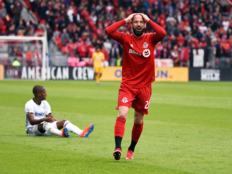 May 11, 2019: Toronto FC defender Laurent Ciman (26) holds his head in disbelief after being awarded a yellow card for a tackle against Philadelphia Union forward Fafa Picault (9) at BMO Field in Toronto, Ontario. Philadelphia defeated Toronto 2-1.