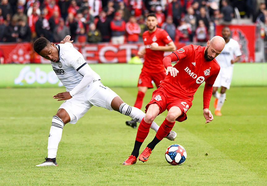 May 11, 2019: Philadelphia Union forward Sergio Santos (17) tackles Toronto FC defender Laurent Ciman (26) at BMO Field in Toronto, Ontario. Philadelphia defeated Toronto 2-1.