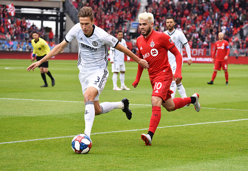 May 11, 2019: Philadelphia Union defender Jack Elliott (3) shields the ball from Toronto FC forward Alejandro Pozuelo (10) during MLS soccer action between Philadelphia Union and Toronto FC at BMO Field in Toronto, Ontario. Philadelphia defeated Toronto 2-1.