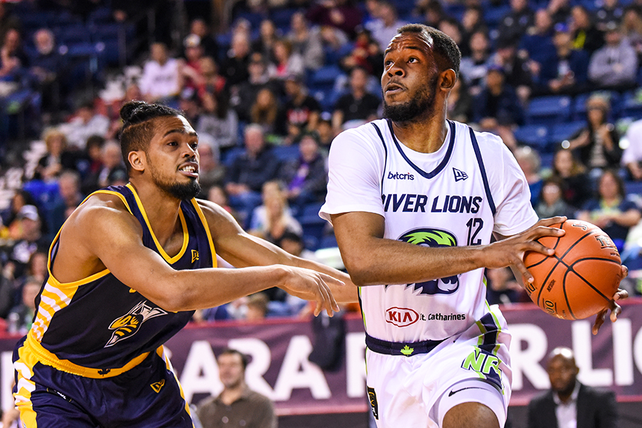 Niagara River Lions forward Yohanny Dalembert (12) is guarded by Edmonton Stingers forward Will Davis II (33), during CEBL action at St. Catharines' Meridian Centre on May 16. The River Lions won the game by a score of 108-66.