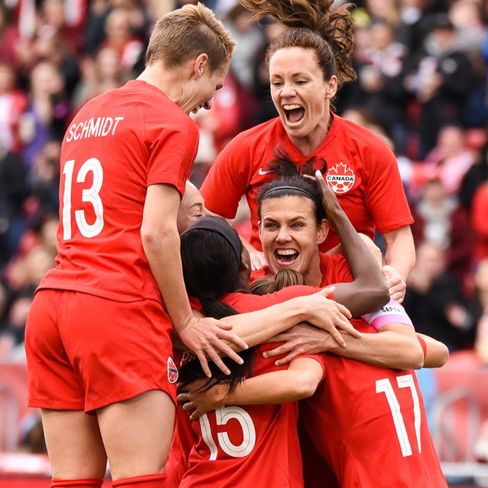 May 18, 2019: Team Canada forward Christine Sinclair (12) is swarmed by her teammates after scoring a goal against Mexico during an international friendly at BMO Field in Toronto, Ontario. Canada defeated Mexico 3-0.