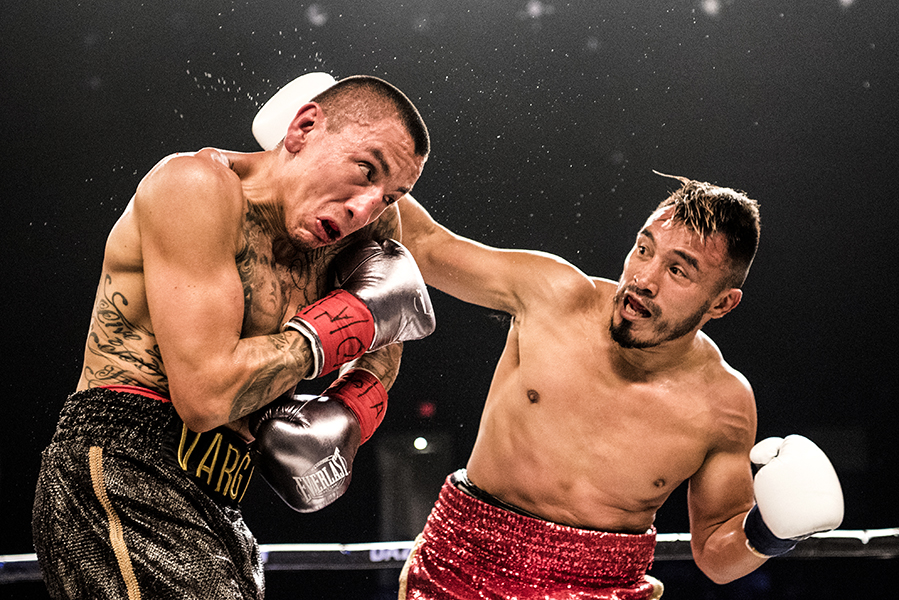 Silverio Ortiz lands a punch to the head of Samuel Vargas during a welterweight bout in Niagara Falls, Ont.
