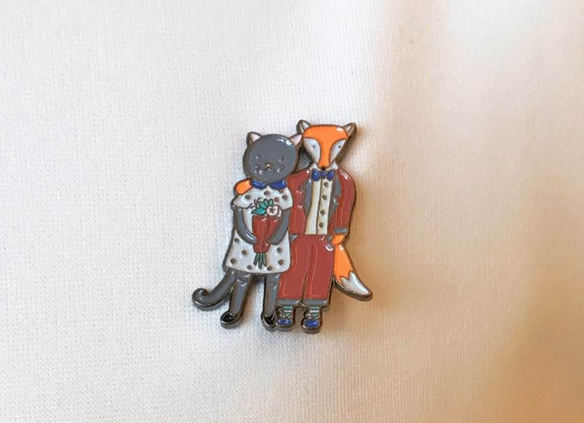 And she progressed to enamel pins, with this one designed fro her wedding!