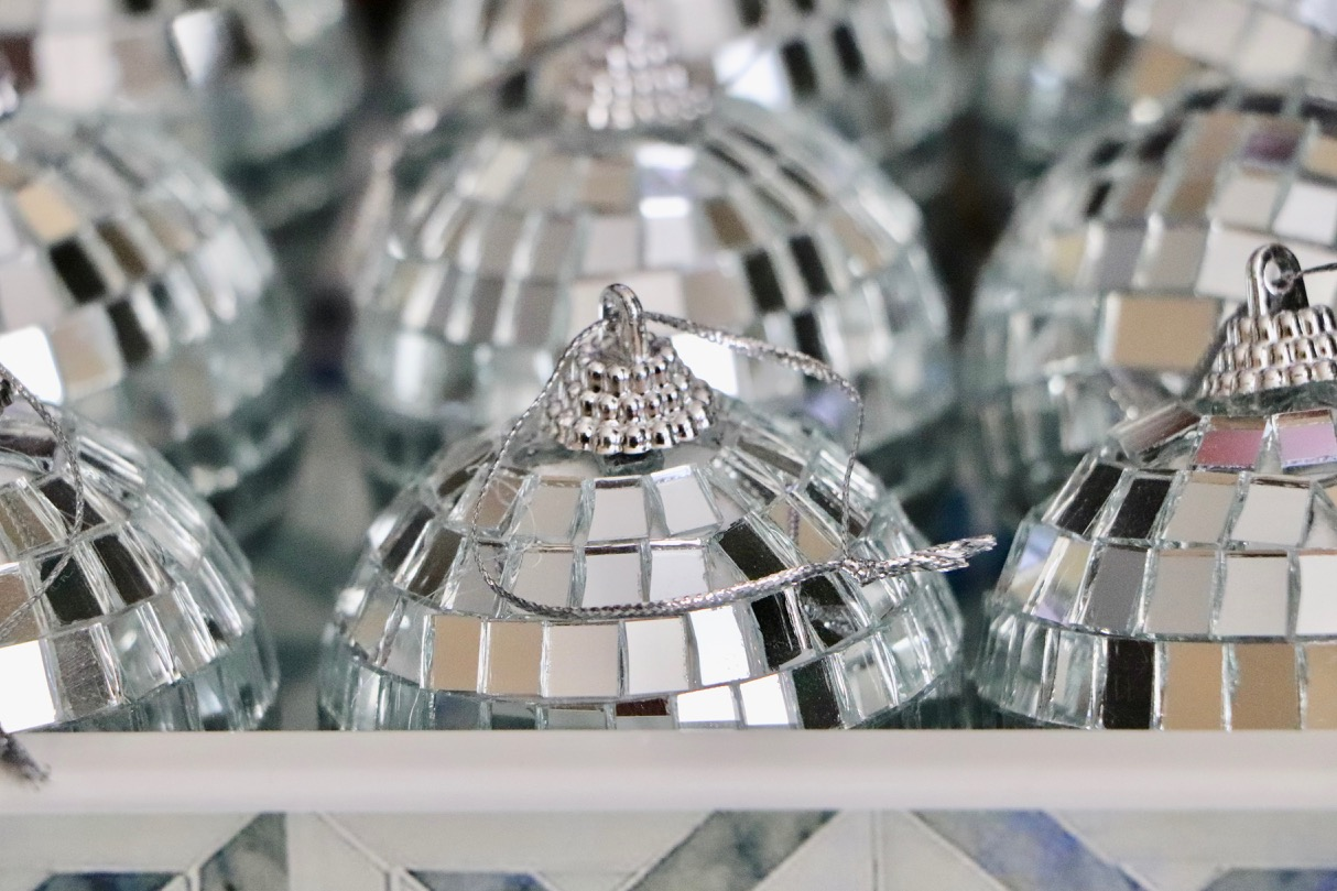 Mirror ball ornaments are a MUST on my Christmas tree! I like to put these on the side of the tree facing the window so that they sparkle in the sunlight during the day!  Photo by: Lighter Side Interiors