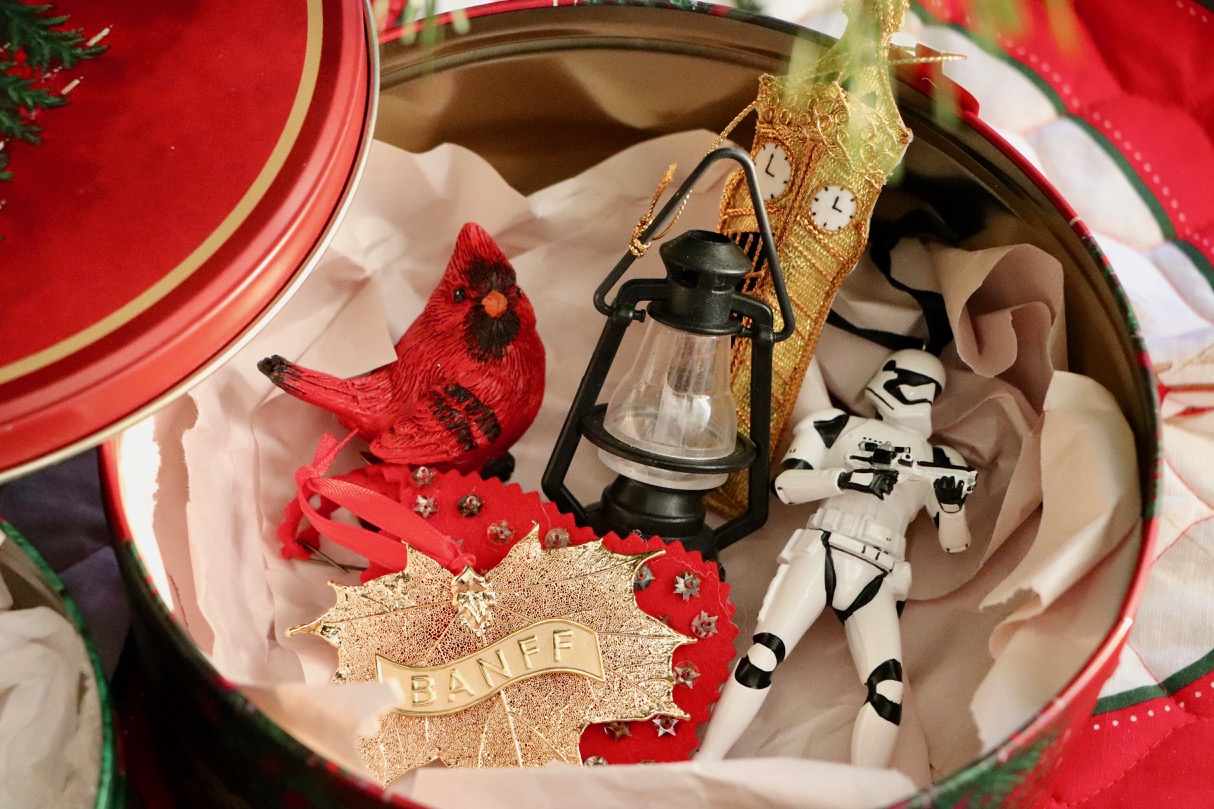 A cookie tin and some newsprint paper is all you need to store those ornaments for next year!  Photo by: Lighter Side Interiors