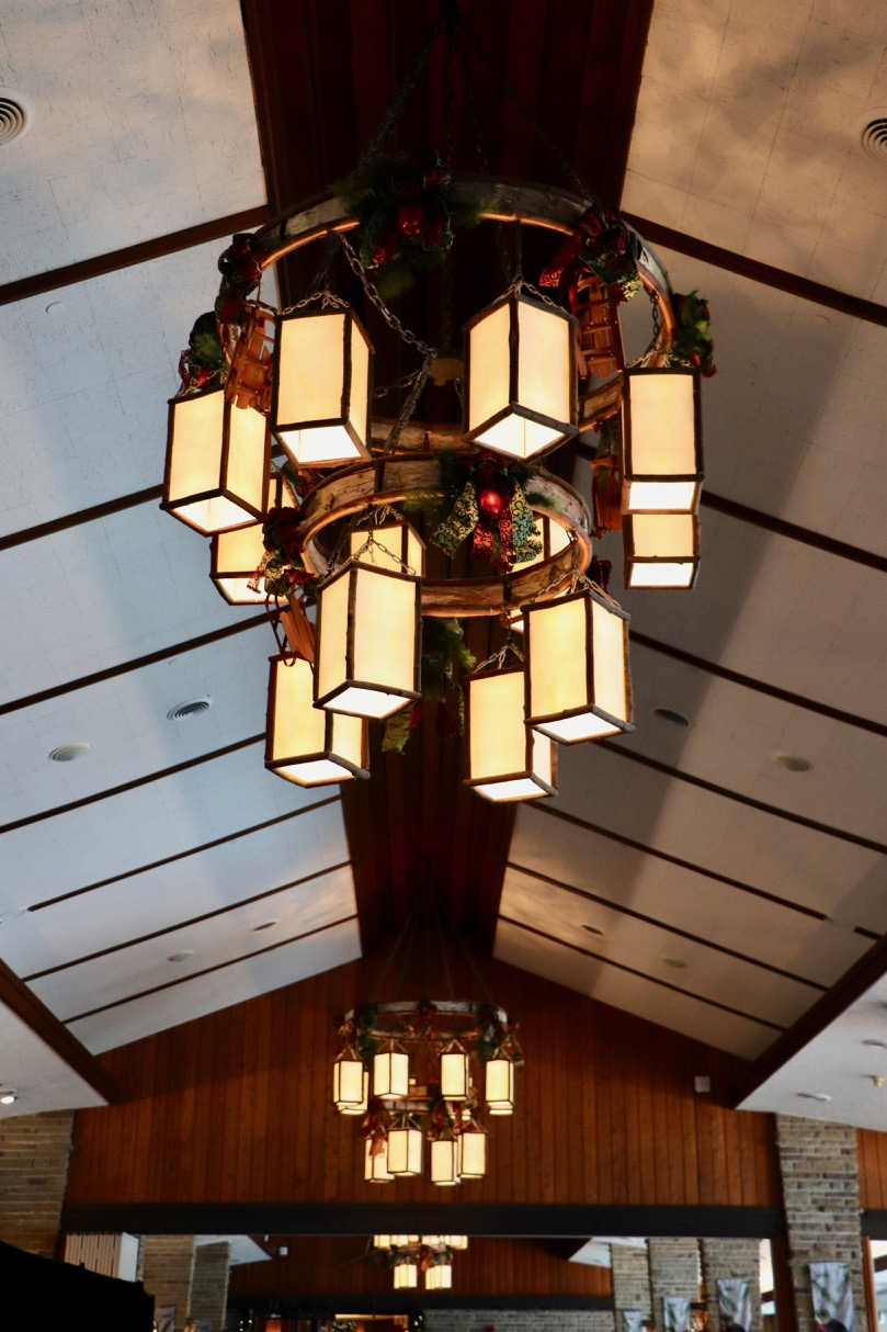 Loved the chandeliers in the Beauvert room! Each one had 12 lanterns hanging from it, and they were decorated in garland and miniature wooden sleighs.