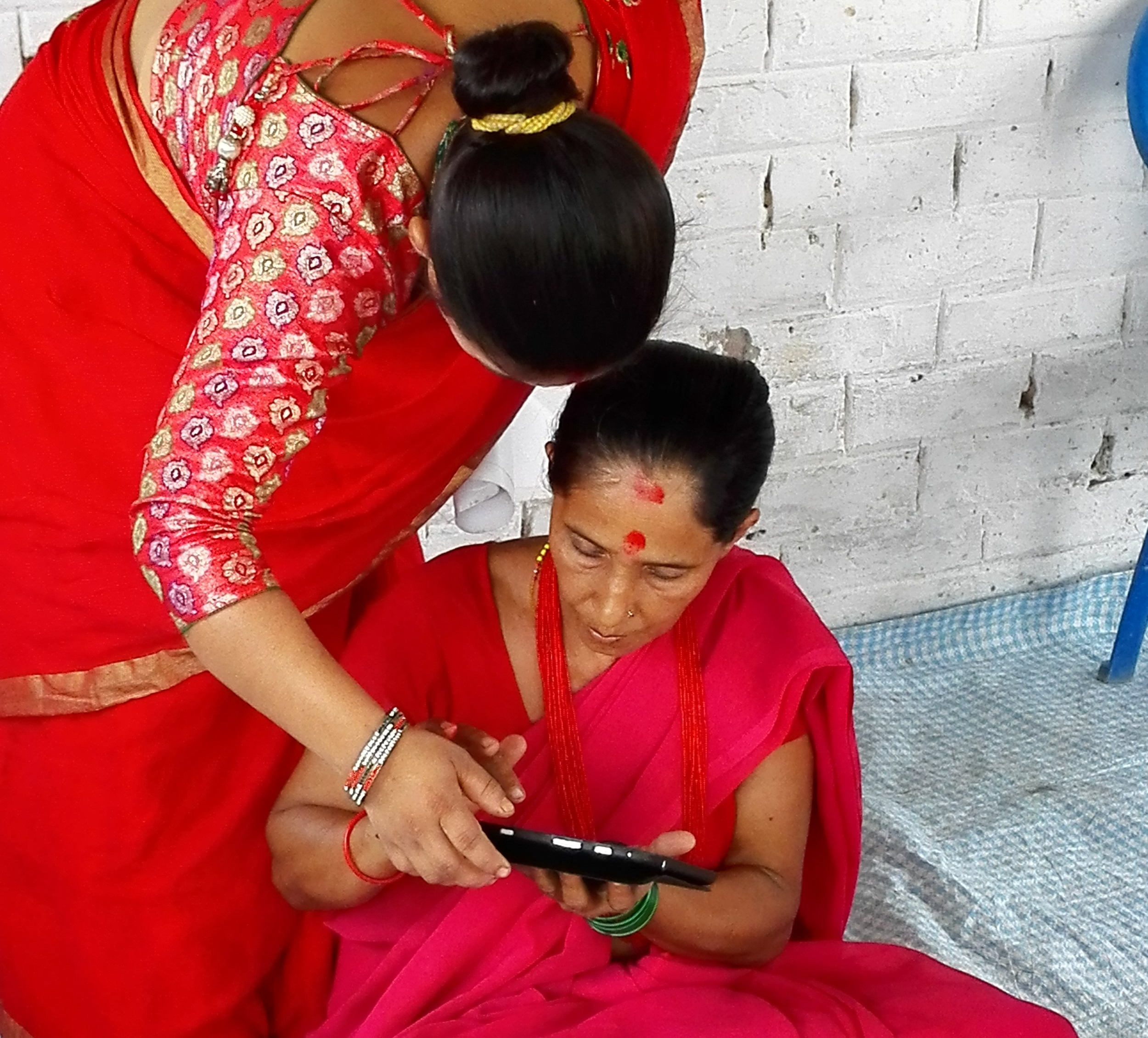 Learners using the tablet for the first time in Nepal.jpg