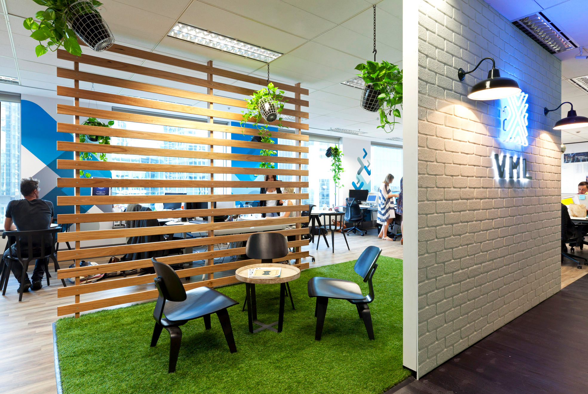 How can biophilic design be integrated into the modern workplace? - There are many ways biophilic design can be incorporated into the workplace, with an array of options that are both obvious, such as greenery and materials, and less obvious, like textures and colours.Plants are a good starting place for bringing nature into the office. Living walls, potted plants and trees are some of the most common examples. Elements of water can also be considered, as well as increased natural sunlight.Use of curvature and avoiding 'sterile' straight lines, emulating natural forms in the shape and layout of space is also possible.Material choice can also be key. Use of natural wood, colours, incorporating botanical or animal motifs can all be beneficial. Using new products designed to mimic nature can also provide the stimulation humans need to benefit from biophilic design.