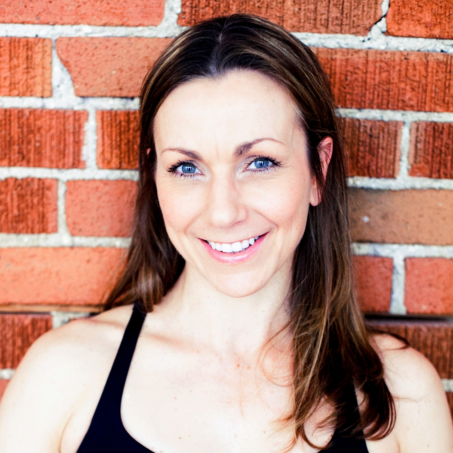 """Glenn's French passion and """"joie de vivre"""" will make you smile every class. She aspires to challenge, educate and inspire every student.  Glenn prescribes smart exercises, and creative yoga sequences. She teaches all the different styles of classes offered at YOGAthletix."""